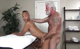 Hot grandpa fucks a young black boy during a massage session