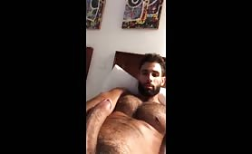 Cute latin stud stroking his huge cock