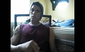 Young dude stroking his cock in front of a webcam