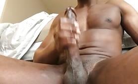 Sexy black guy stroking his horse cock