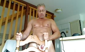 Cute mature guy playing solo with his toy