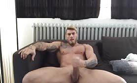 Beautiful muscular blond masturbating on his sofa