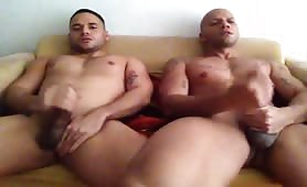 Two hot muscular friends masturbate while watching porn