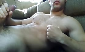 Cute stud relaxes masturbating while chatting on his computer