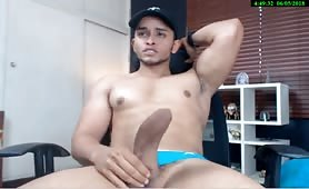 Handsome guy playing with his big fat cock