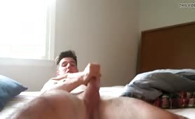 Hottie wanks his nice cock on bed