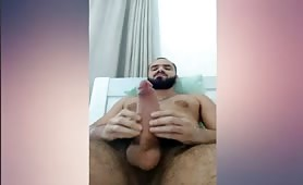 Big hairy bear stroking his huge cock solo