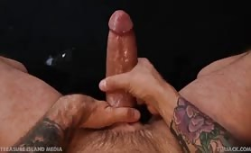 Sexy tattooed stud jacking off his long tasty cock