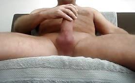 Horny dad stroking his huge uncut cock solo