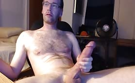 Hairy dad stroking his long monster
