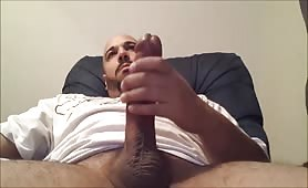 Horny black guy wanking his huge mushroom head cock