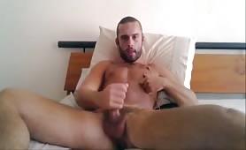 Sexy bearded stud wanking his tasty fat cock
