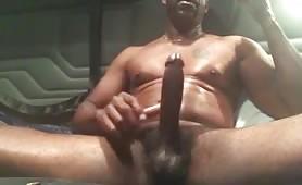 Handsome mature black guy stroking his huge tasty cock