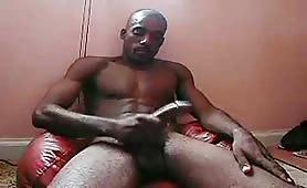 Bushy black thug showing his massive delicious cock