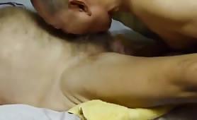 Asian grandpa sucking hairy cock