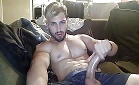 Hot hunk with a huge curved cock